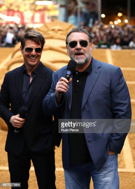 Tom Cruise and Russell Crowe answer questions during a photo call for The Mummy at World Square on May 23 2017 in Sydney Australia