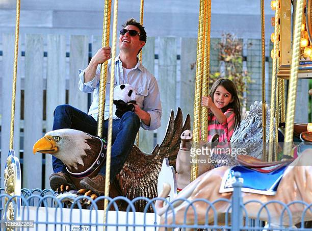 Tom Cruise and Suri Cruise visit Schenley Plaza's carousel on October 8 2011 in Pittsburgh Pennsylvania