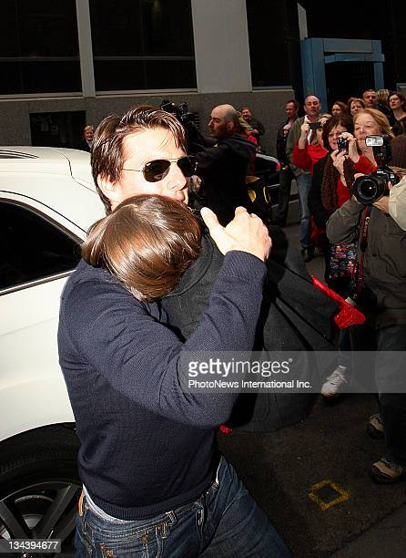 Tom Cruise carries daughter Suri while attending the stage production of 'Jersey Boys The Story Of Frankie Valli The Four Seasons' at Princess...