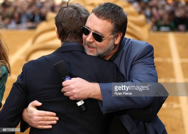 Tom Cruise greets Russell Crowe during a photo call for The Mummy at World Square on May 23 2017 in Sydney Australia