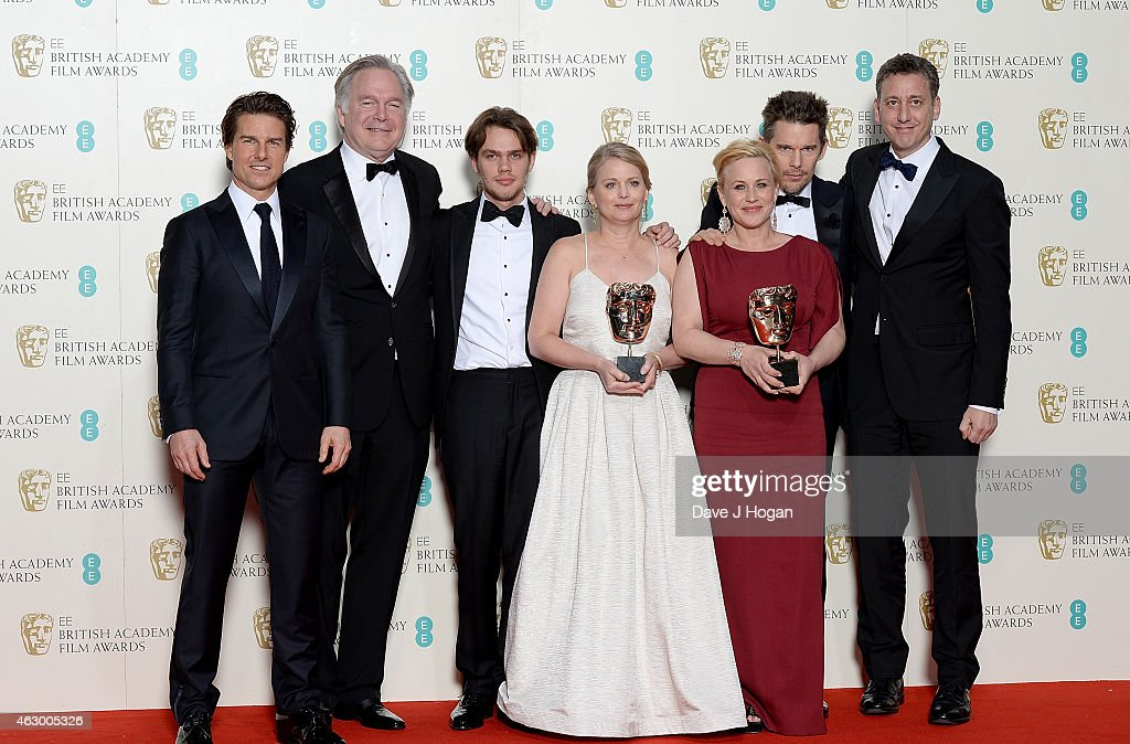 Tom Cruise, Jonathan Sehring, Ellar Coltrane, Cathleen Sutherland, Patricia Arquette, Ethan Hawke and John Sloss celebrate Best Film 'Boyhood' in the winners room with the award for Best Film for 'Boyhood', at the EE British Academy Film Awards at The Royal Opera House on February 8, 2015 in London, England.