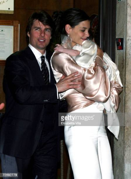 Tom Cruise Katie Holmes and their daughter Suri leave a restaurant in central Rome after the dinner on November 17 2006 in Rome Italy