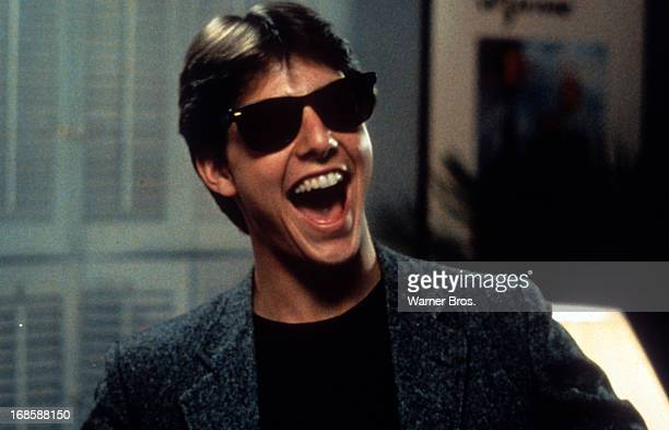 Tom Cruise laughs in a scene from the film 'Risky Business', 1983.