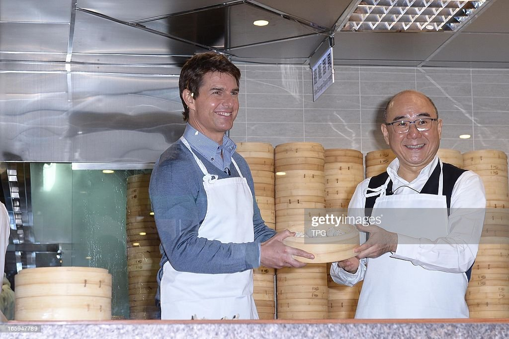 Tom Cruise learned how to make small steamed buns with chef in Din Tai Fung Dumpling House on Saturday April 06, 2013 in Taipei, Taiwan, China.