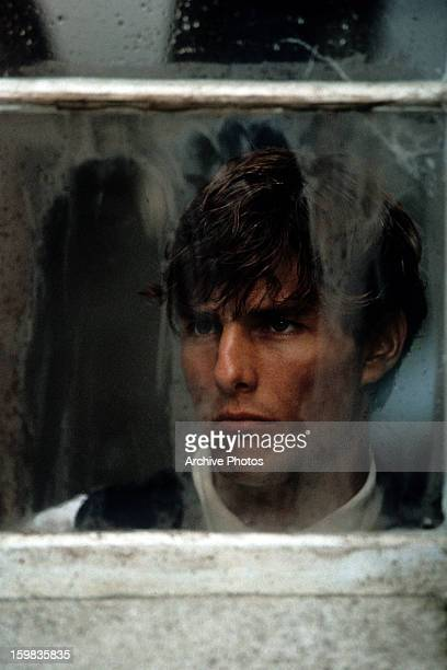 Tom Cruise looking out dirty window in a scene from the film 'Far And Away' 1992