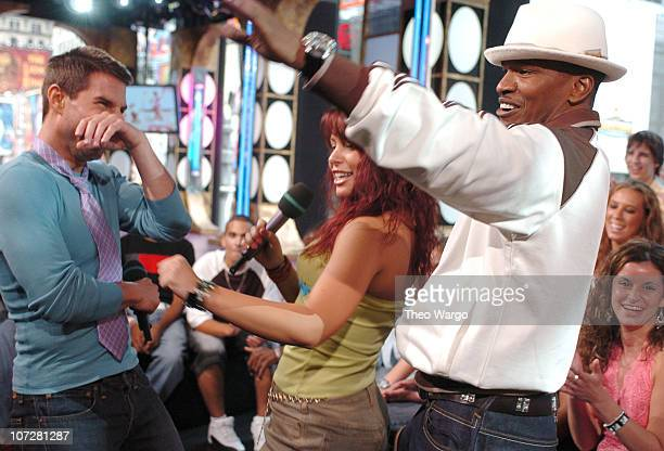 Tom Cruise MTV fan and Jamie Foxx during Tom Cruise Jamie Foxx and Jada Pinkett Smith Visit MTV's TRL August 5 2004 at MTV Studios Times Square in...