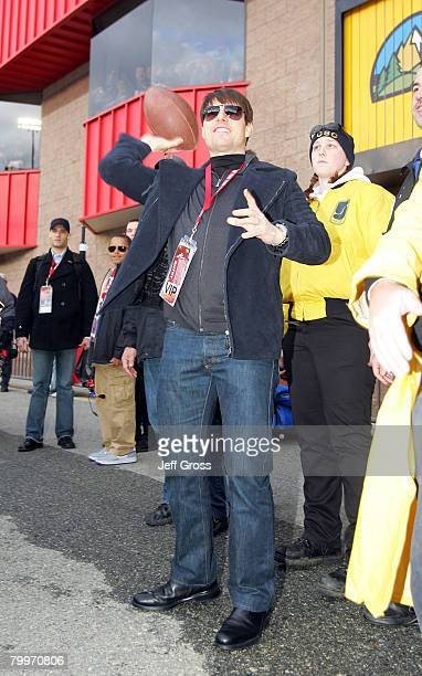 Tom Cruise plays catch during the NASCAR Sprint Cup Series Auto Club 500 at the Auto Club Speedway of Southern California on February 24, 2008 in...