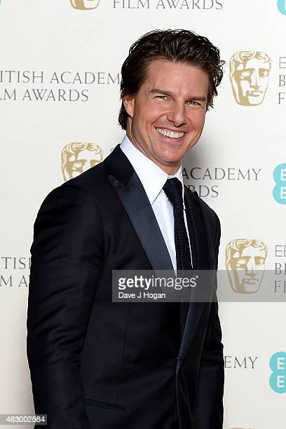 Tom Cruise poses in the winners room at the EE British Academy Film Awards at The Royal Opera House on February 8 2015 in London England