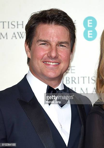 Tom Cruise poses in the winners room at the EE British Academy Film Awards at The Royal Opera House on February 14 2016 in London England