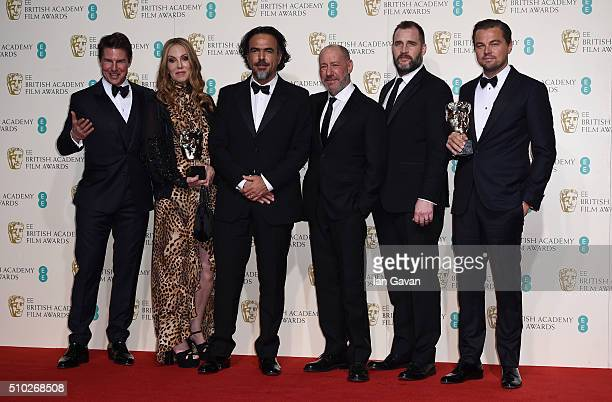 Tom Cruise poses with Best Film winners Mary Parent Alejandro Gonzalez Inarritu Steve Golin Keith Redmon and Best Actor winner Leonardo DiCaprio for...