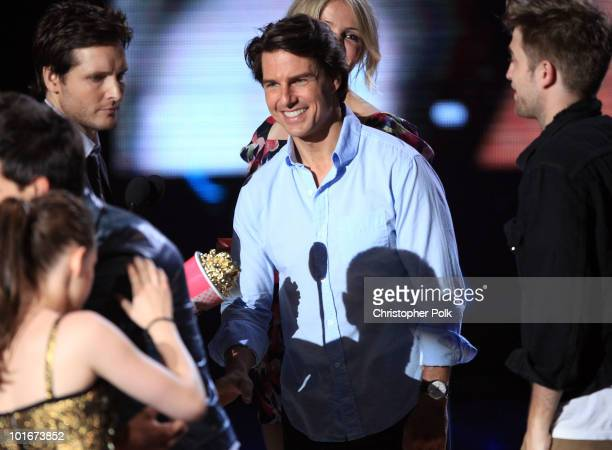 Tom Cruise presents the Best Movie award to the cast of Twilight Saga New Moon onstage at the 2010 MTV Movie Awards held at the Gibson Amphitheatre...