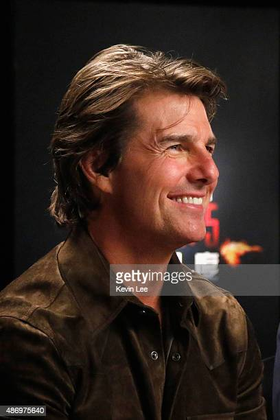 Tom Cruise reacts during a telebroadcasting with fans in a cinema in Chengdu on August 5 2015 in Shanghai China
