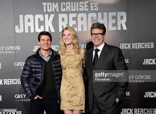 Tom Cruise Rosamund Pike and Christopher McQuarrie attend the premiere of 'Jack Reacher' at Callao Cinema on December 13 2012 in Madrid Spain