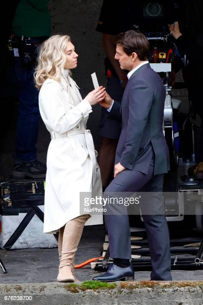 Tom Cruise seen kissing Vanessa Kirby during a scene for 'Mission Impossible 6' in Paris France on May 2 2017
