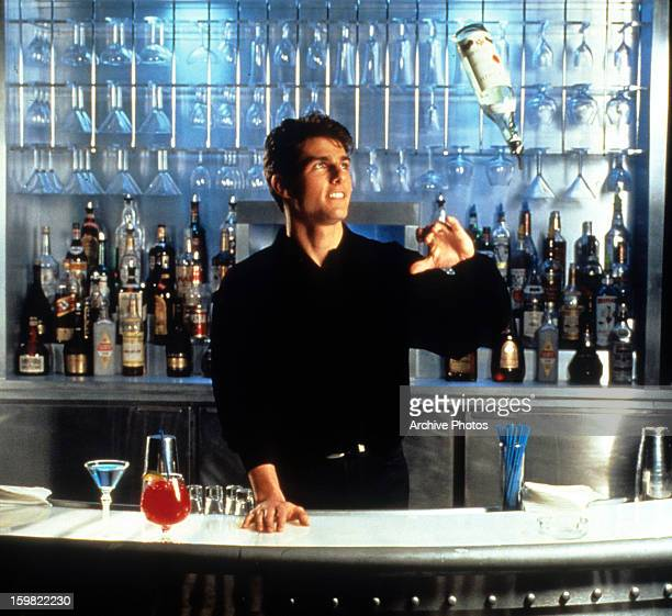 Tom Cruise showing his tricks as a bartender in a scene from the film 'Cocktail' 1988