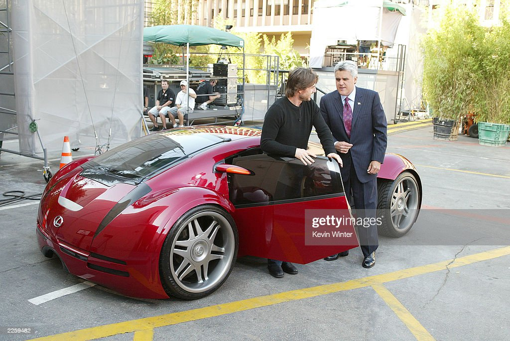 https://media.gettyimages.com/photos/tom-cruise-showing-jay-the-lexus-used-in-the-minority-report-on-the-picture-id2259482