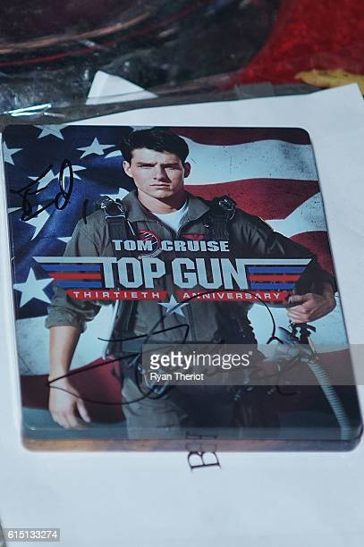 Tom Cruise signed a Top Gun 30th Anniversary box set on the red carpet for 'Jack Reacher Never Go Back' Fan Screening at AMC Elmwood Palace 20 on...