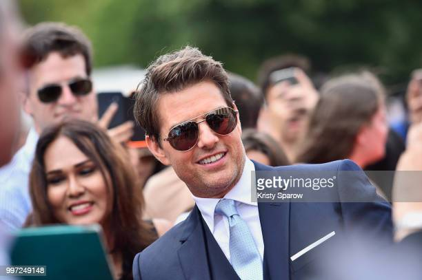 Tom Cruise signing autographs with fans during the Global Premiere of 'Mission Impossible Fallout' at Palais de Chaillot on July 12 2018 in Paris...