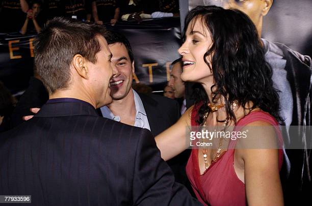 Tom Cruise, Steven Roy and Carrie-Anne Moss