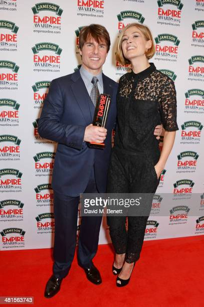 Tom Cruise winner of the Legend Of Our Lifetime award and Rosamund Pike pose in the press room at the Jameson Empire Awards 2014 at The Grosvenor...