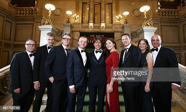 Tom Cruise with cast and filmmakers pose during the world premiere of 'Mission Impossible Rogue Nation' at the Opera House on July 23 2015 in Vienna...