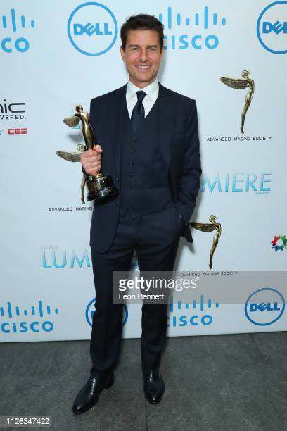 Tom Cruise with the Lumiere Award for Best Scene or Sequence for Mission Impossible Fallout attends 10th Annual Lumiere Awards at Warner Bros Studios...
