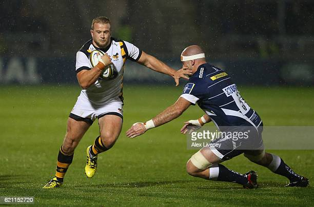 Tom Cruse of Wasps beats Lou Reed of Sale Sharks during the AngloWelsh Cup match between Sale Sharks and Wasps at AJ Bell Stadium on November 4 2016...