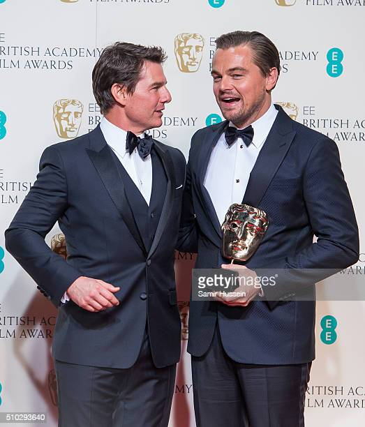Tom Crusie and Leonardo DiCaprio pose in the winners room at the EE British Academy Film Awards at The Royal Opera House on February 14 2016 in...