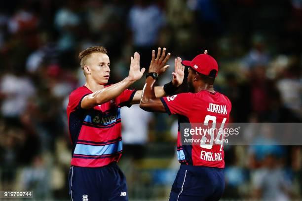 Tom Curran and Chris Jordan of England celebrate after winning the International Twenty20 match between New Zealand and England at Seddon Park on...