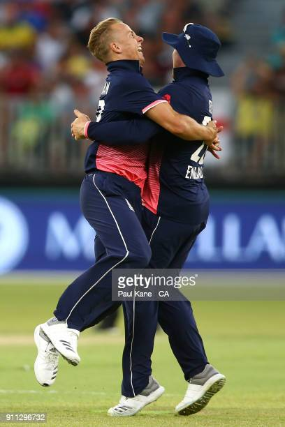 Tom Curran and Jason Roy of England celebrate the wicket of Adam Zampa of Australia during game five of the One Day International match between...