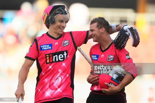 Tom Curran and Josh Philippe of the Sixers celebrate their win during the Big Bash League match between the Brisbane Heat and the Sydney Sixers at...