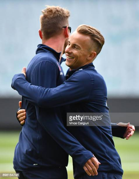 Tom Curran hugs Stuart Broad during a warm up soccer game during an England nets session at the MCG on December 25 2017 in Melbourne Australia