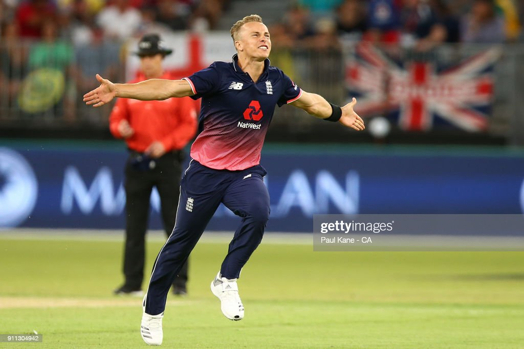 Tom Curran of England celebrate the wicket of Tim Paine of Australia during game five of the One Day International match between Australia and England at Perth Stadium on January 28, 2018 in Perth, Australia.