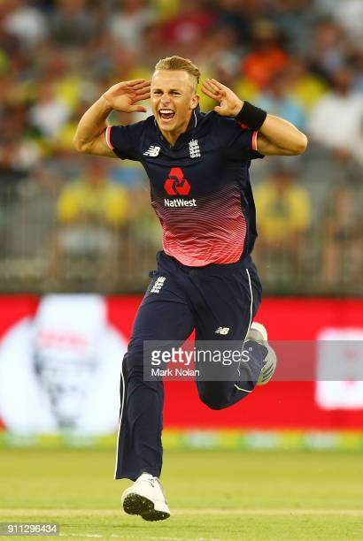 Tom Curran of England celebrates a wicket during game five of the One Day International match between Australia and England at Perth Stadium on...