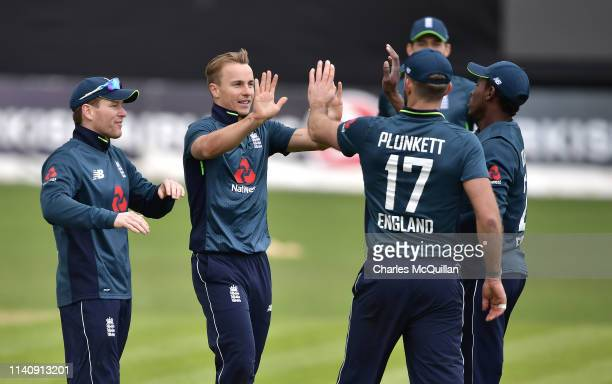 Tom Curran of England celebrates after taking the opening wicket during the ODI cricket match between Ireland and England at Malahide Cricket Club on...