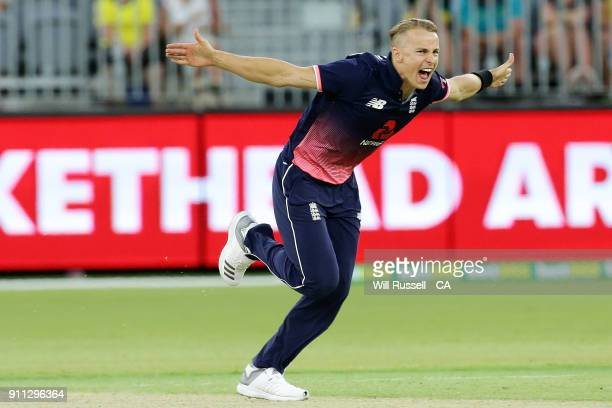 Tom Curran of England celebrates after taking the wicket of Adam Zampa of Australia during game five of the One Day International match between...