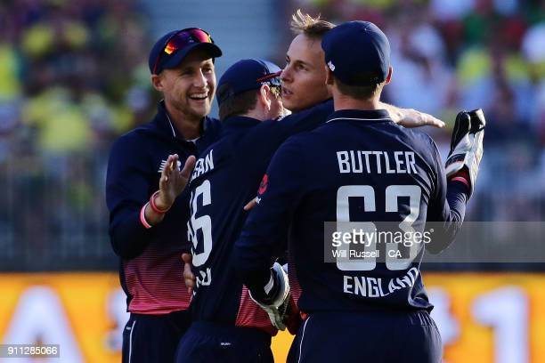 Tom Curran of England celebrates after taking the wicket of Mitchell Starc of Australia during game five of the One Day International match between...
