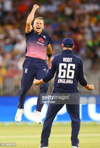 Tom Curran of England celebrates getting the final wicket to win game five of the One Day International match between Australia and England at Perth...