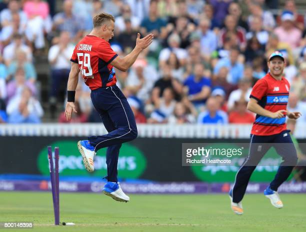 Tom Curran of England celebrates taking the wicket of Andile Phehlukwayo of South Africa during the 2nd NatWest T20 International match between...