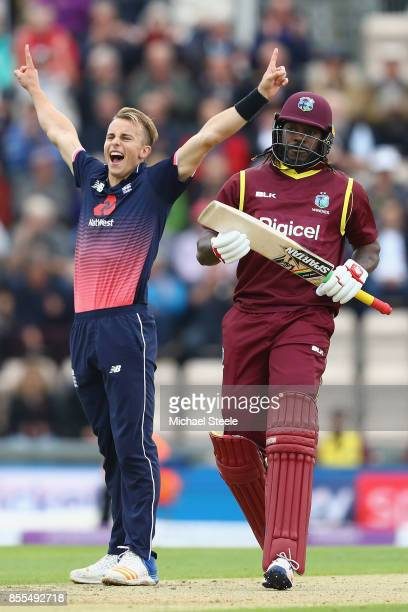 Tom Curran of England celebrates taking the wicket of Chris Gayle of West Indies during the 5th Royal London One Day International match between...