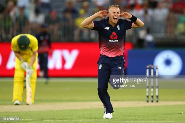 Tom Curran of England celebrates the wicket of Adam Zampa of Australia during game five of the One Day International match between Australia and...
