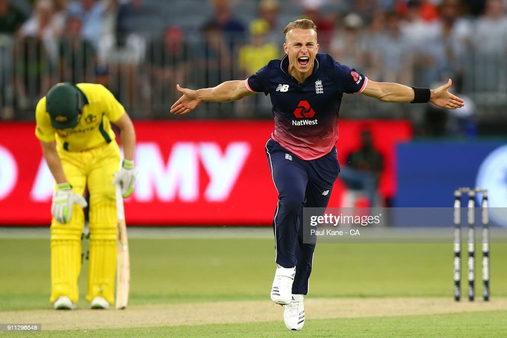 Tom Curran of England celebrates the wicket of Adam Zampa of Australia during game five of the One Day International match between Australia and England at Perth Stadium on January 28, 2018 in Perth, Australia.