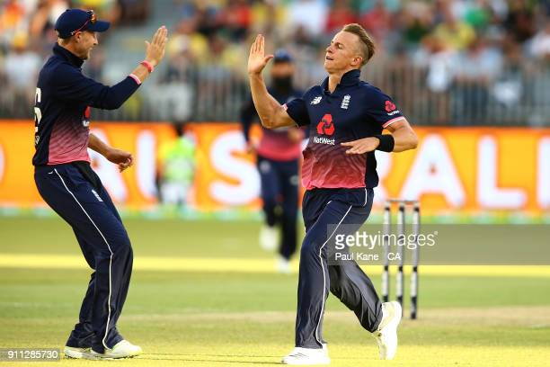 Tom Curran of England celebrates the wicket of Mitchell Starc of Australia during game five of the One Day International match between Australia and...