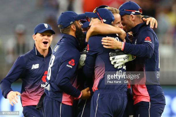 Tom Curran of England celebrates the wicket of Tim Paine of Australia with team mate and winning game five of the One Day International match between...