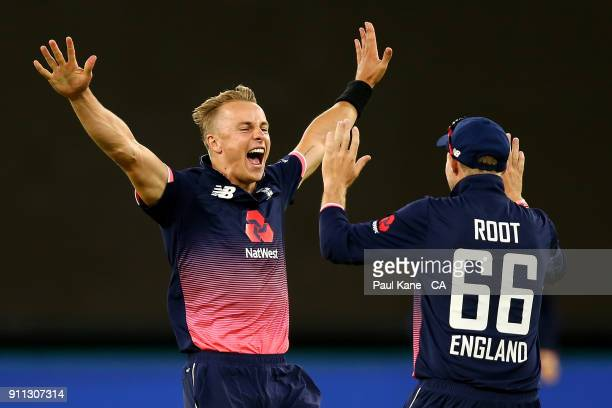 Tom Curran of England celebrates the wicket of Tim Paine of Australia with Joe Root during game five of the One Day International match between...