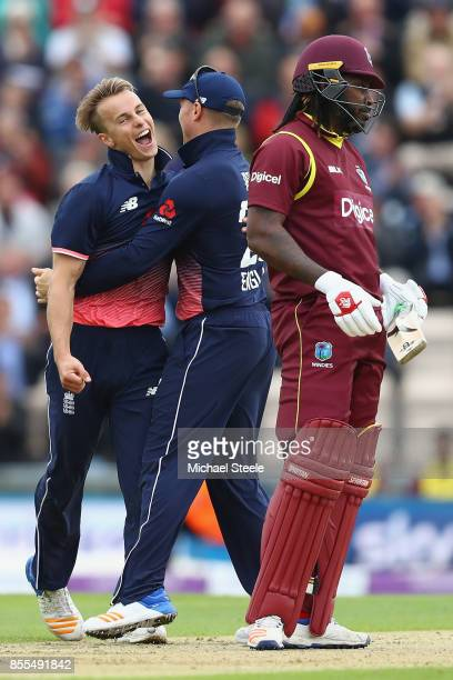 Tom Curran of England celebrates with Jason Roy taking the wicket of Chris Gayle of West Indies during the 5th Royal London One Day International...