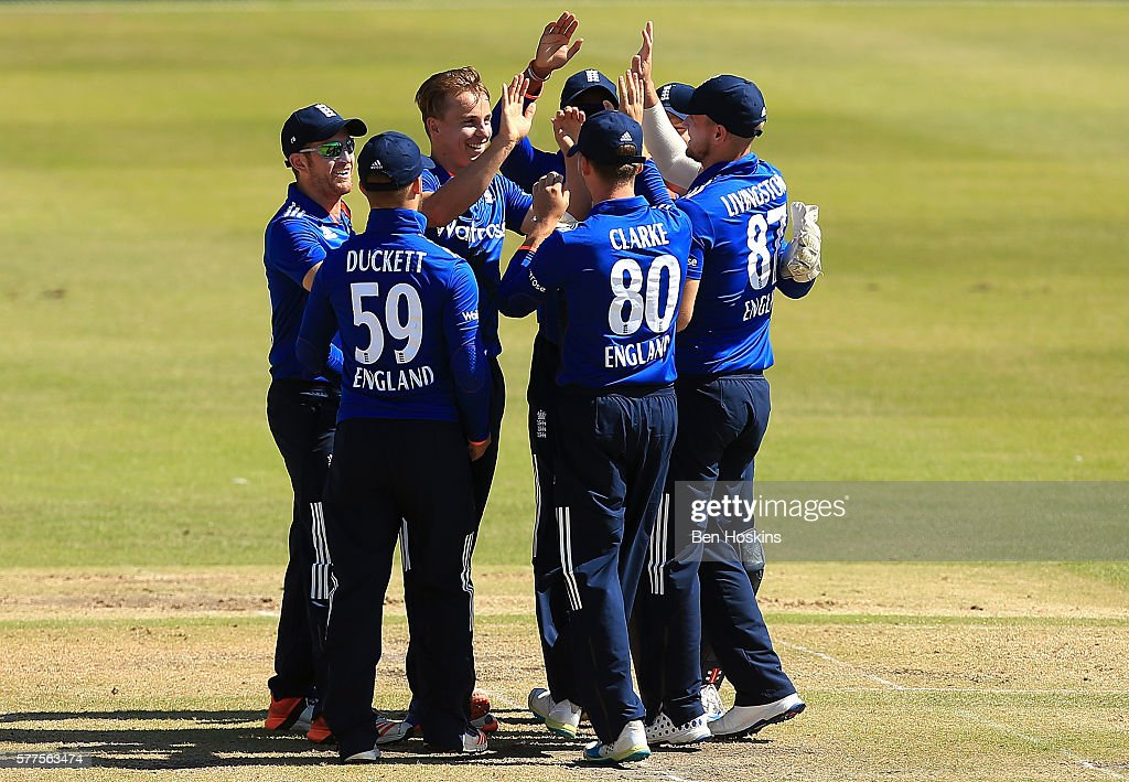 Tom Curran of England celebrates with team mates after dismissing Fakhar Zaman of Pakistan during the Triangular Series match between England Lions and Pakistan A on July 19, 2016 in Cheltenham, England.