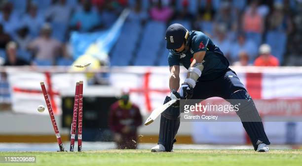 Tom Curran of England is bowled by Oshane Thomas of the West Indies during the Fifth One Day International match between England and West Indies at...