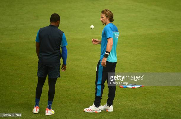 Tom Curran of England looks on as they interact with team mate Chris Jordan during an England Nets Session at Sophia Gardens on June 21, 2021 in...