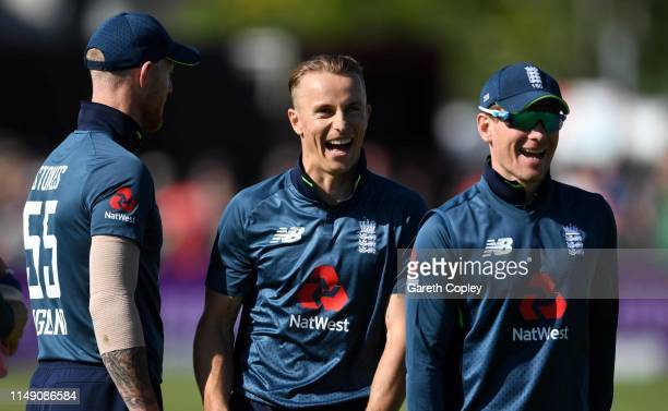 Tom Curran of England shares a joke with captain Eoin Morgan during the 3rd Royal London One Day International between England and Pakistan at The...